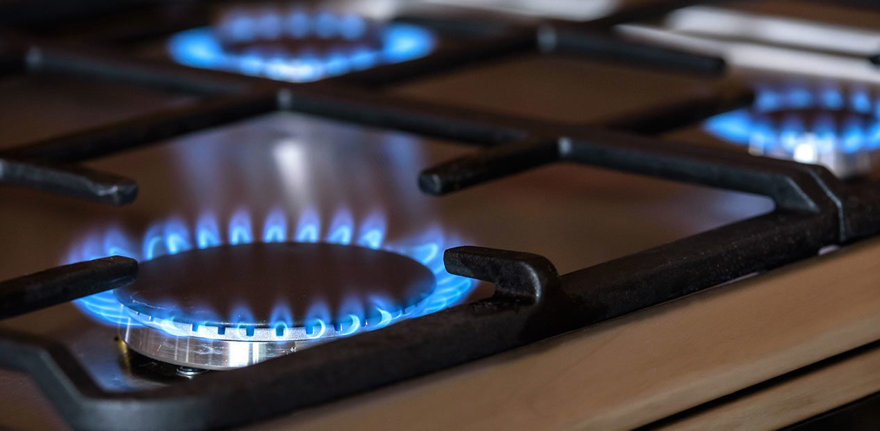 Gas Cooker Stove turned on showing blue flame